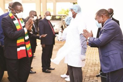 President Emmerson Mnangagwa and his Mozambican counterpart President Filipe Nyusi exchange greetings in Chimoio, Mozambique.