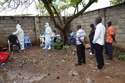 Residents of Kawangware in Nairobi, Kenya, get ready to be tested for the novel coronavirus.