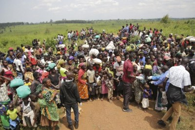 Asylum-seekers from the Democratic Republic of the Congo wait for health screening near the border in Zombo, Uganda.
