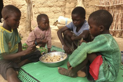 With schools closed as a preventitive measure taken by the govern to curb the spread of Covid-19 in the Country, WFP is providing Take-Home Rations (THR) to ensure that pupils continue to study at home on a full sltomach. In the photo: Doudou Ltanoua's (non visible in the Photo) school-aged children enjoy a hot meal cooked with food items provided by WFP (file photo).