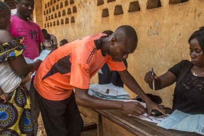 An official processes voter ID cards ahead of the general elections in the Central African Republic.