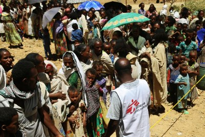 An MSF translator asks people to line up to wait for medical consultations at a mobile clinic in Adiftaw (file photo).