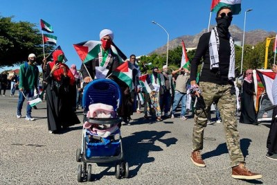 South African demonstrators march to Parliament to protest against Israeli air strikes in the Gaza Strip during May, 2021.