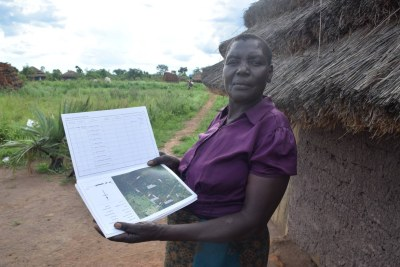 Santa Otyeka with her certificate of customary ownership, in Pader district, Uganda, on May 5, 2021 (file photo).