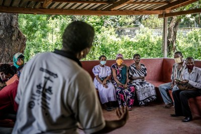 A group of men and women discuss gender-based violence with a gender specialist at Kilifi County Hospital in Kilifi, Kenya (file photo).
