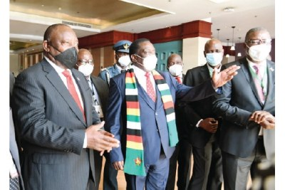South African President Cyril Ramaphosa, left, and Zimbabwean President Emmerson Mnangagwa, wearing scarf, on the sidelines of the 41st Summit of SADC Heads of State and Government in Lilongwe, Malawi, August 17, 2021.